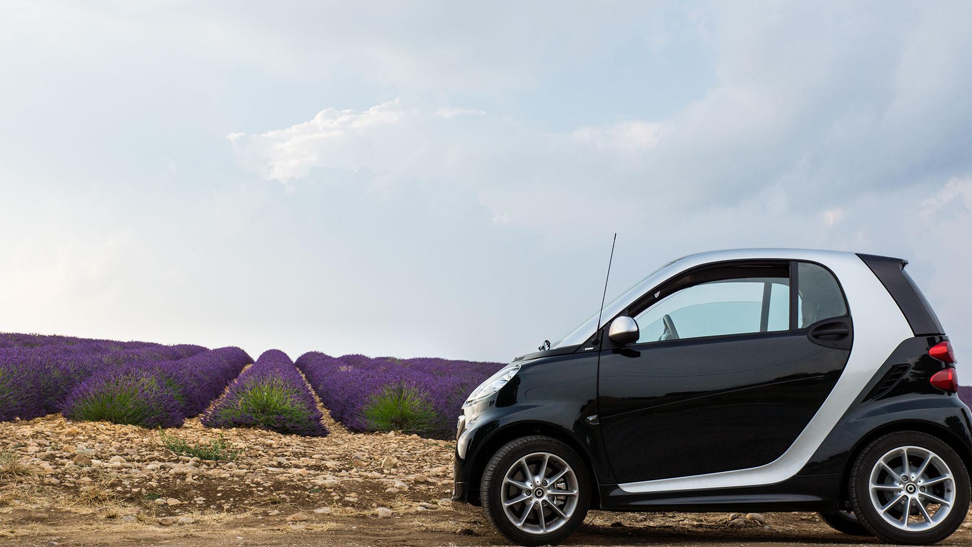 a parked smart car