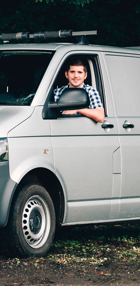 Young man in his van