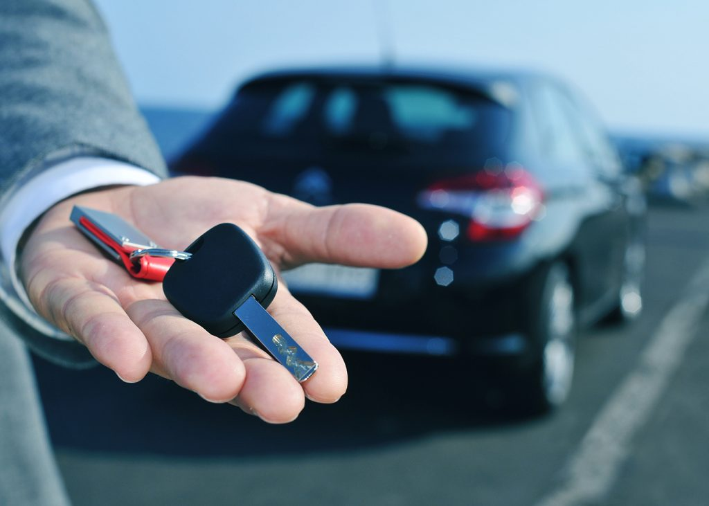 Man holding car keys for his hire car