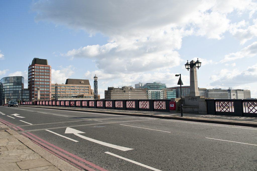 Arrow merging sign on the road on Lambeth Bridge, London, UK